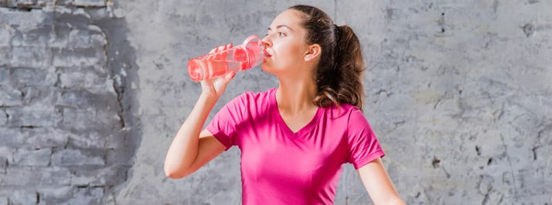 Woman drinking water to relieve a phentermine headache