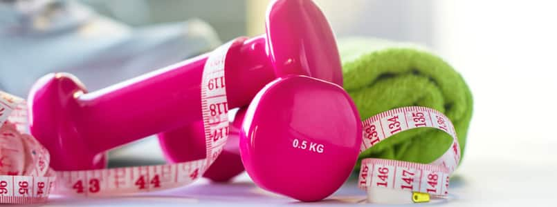 pink weights and a measuring tape