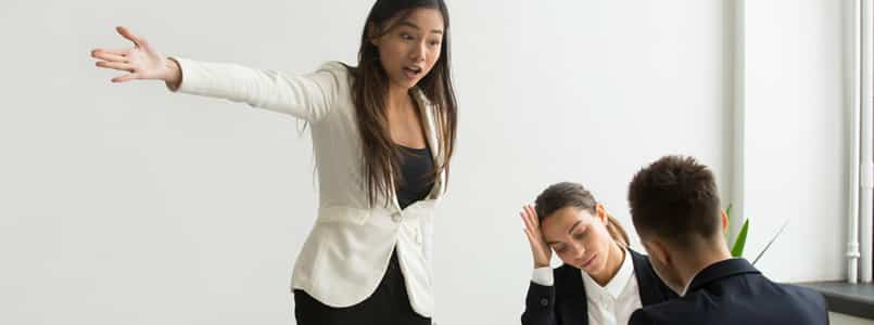 frustrated woman lecturing coworkers