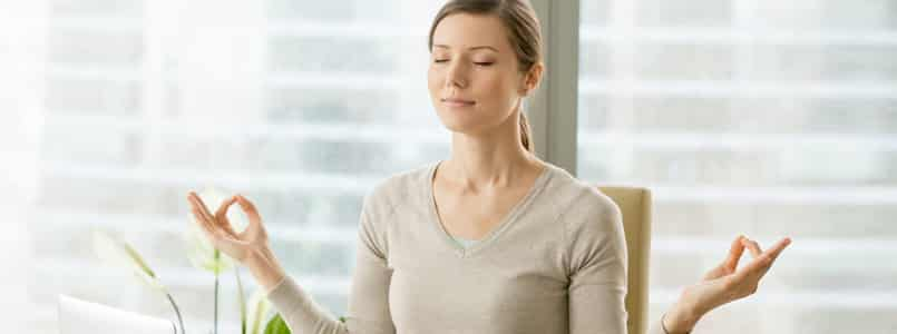 Woman meditating to cope with phentermine mood swings
