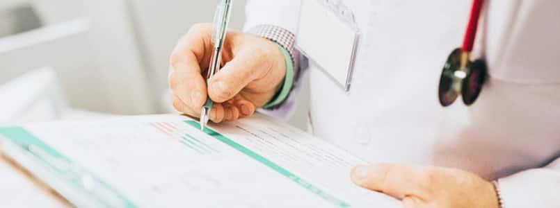 doctor writing a phentermine prescription