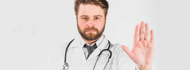 "Doctor with hand extended to say ""no"""