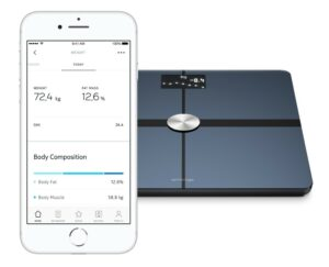 withings body+ scale, shown alongside a smartphone